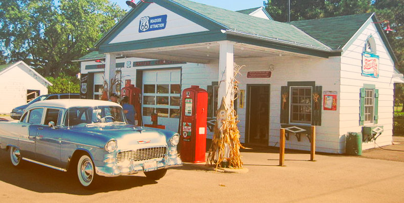 old gas station with blue vintage car