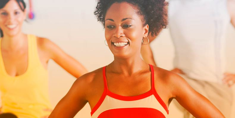women smiling in fitness attire